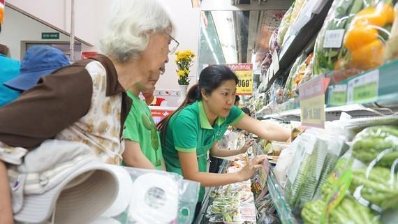 Les detaillants vietnamiens font des efforts pour gagner des parts de marche hinh anh 1