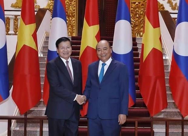 Le Premier ministre laotien termine sa visite officielle au Vietnam hinh anh 1