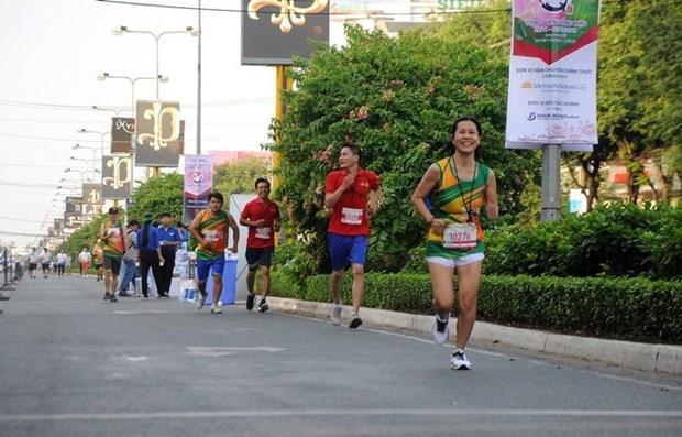 Plus de 2.000 sportifs en lice a un tournoi de marathon a Can Tho hinh anh 1