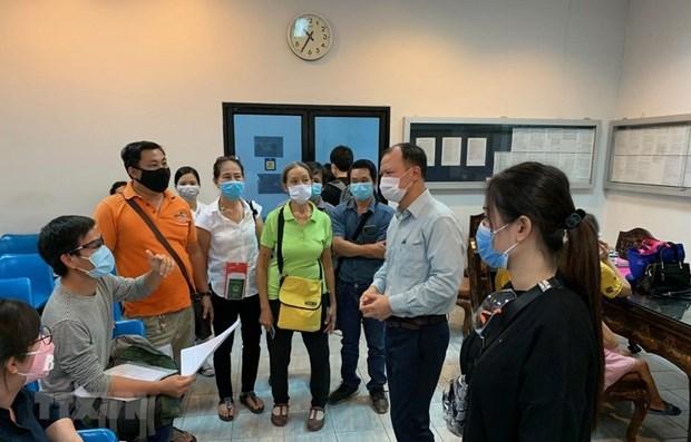 COVID-19 : assistance aux citoyens vietnamiens en transit en Thailande et a Singapour hinh anh 1