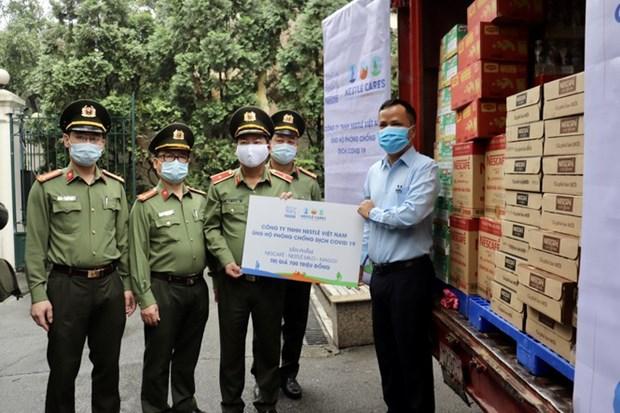 Nestle Vietnam soutient 12 milliards de dongs dans la lutte contre le COVID-19 hinh anh 1