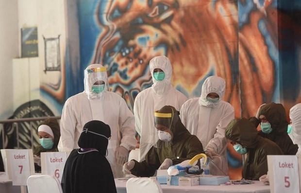 COVID-19: la situation pandemique dans certains pays d'Asie du Sud-Est hinh anh 1