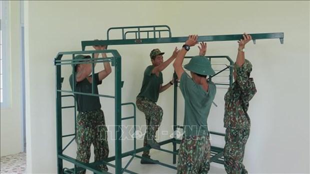 Des soldats en premiere ligne dans le combat contre le COVID-19 hinh anh 1