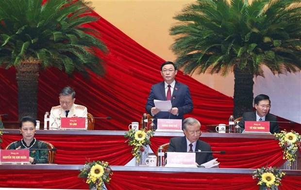 Continuer de discuter des projets de documents soumis au 13e Congres national du Parti hinh anh 1