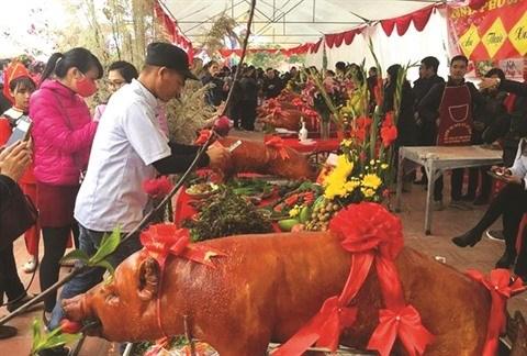 Originalite des fetes du cochon roti a Lang Son hinh anh 1