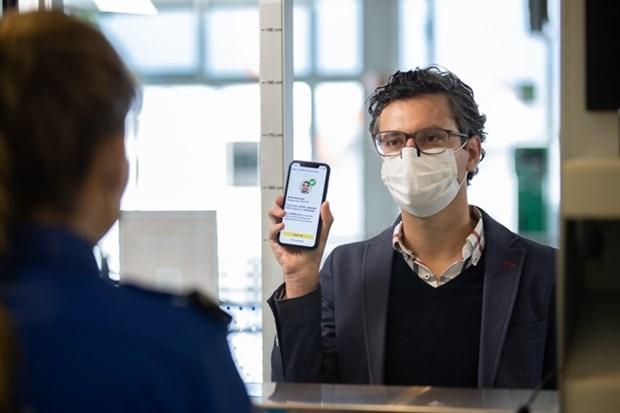 Vietjet applique a titre experimental le passeport sanitaire electronique IATA Travel Pass hinh anh 1