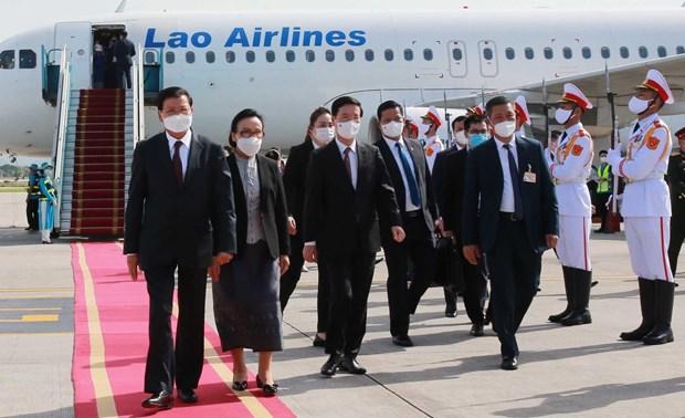 La presse lao apprecie la visite d'amitie officielle au Vietnam du SG du Parti et president lao hinh anh 1