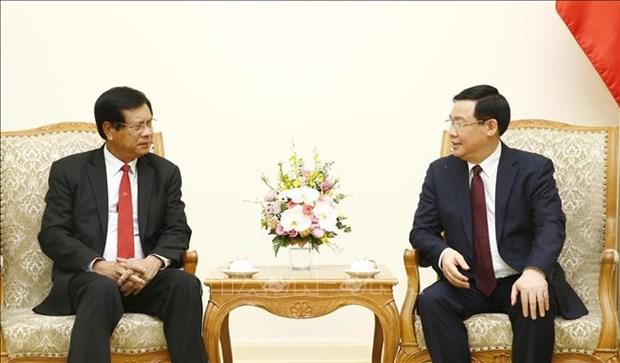 Vietnam et Laos partagent des experiences dans le developpement des cooperatives hinh anh 1
