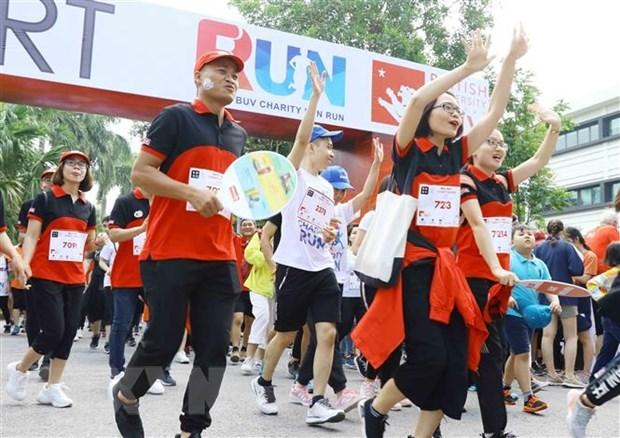 Pres de 8.000 participants a la course caritative Fun Run hinh anh 1