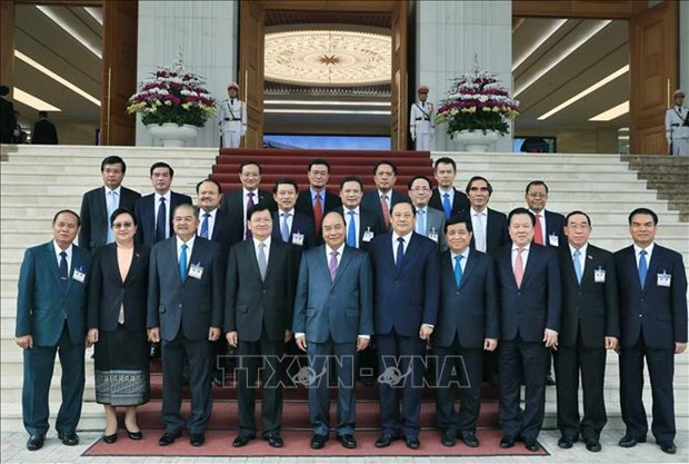 Le PM laotien termine sa visite au Vietnam pour copresider une session intergouvernementale hinh anh 1