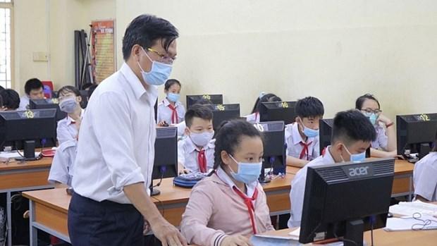 Les gens ont un acces egal au systeme educatif moderne hinh anh 1