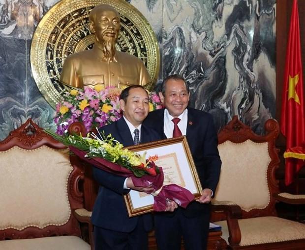 Le vice-president de la Cour populaire supreme du Laos a l'honneur hinh anh 1