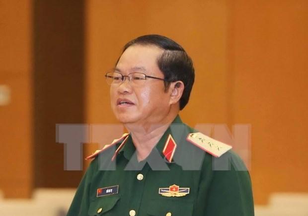Visite officielle d'une delegation militaire vietnamienne au Laos hinh anh 1