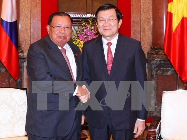 Le president Truong Tan Sang plaide pour les liens speciaux Vietnam-Laos hinh anh 1