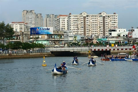En barque au fil du canal Nhieu Loc - Thi Nghe hinh anh 2