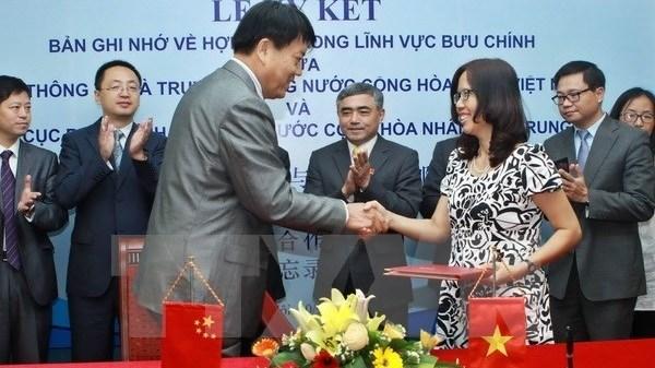 Vietnam-Chine : renforcement de la cooperation dans le secteur postal hinh anh 1