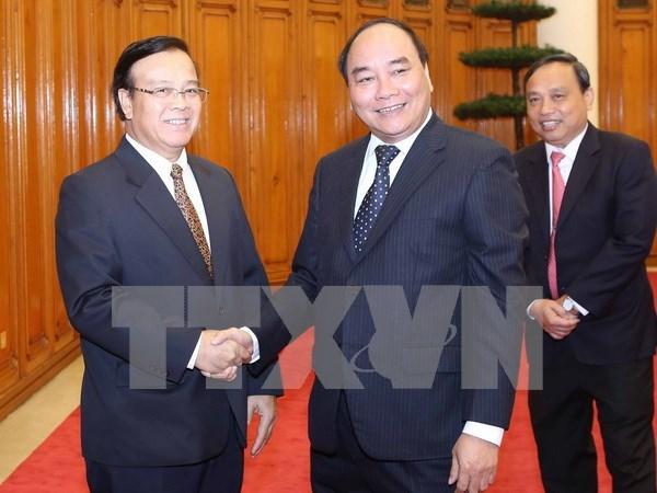 Le vice-PM Nguyen Xuan Phuc appuie les projets d'investissement du Vietnam au Laos hinh anh 1