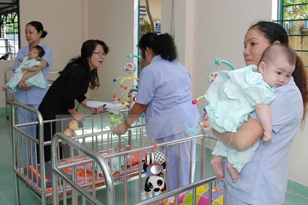 Des enfants vulnerables beneficient de services psychologiques d'un projet de WWO hinh anh 1