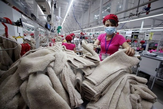 Textile-Habillement : previsions d'exportations de 27,5 milliards de dollars en 2015 hinh anh 1