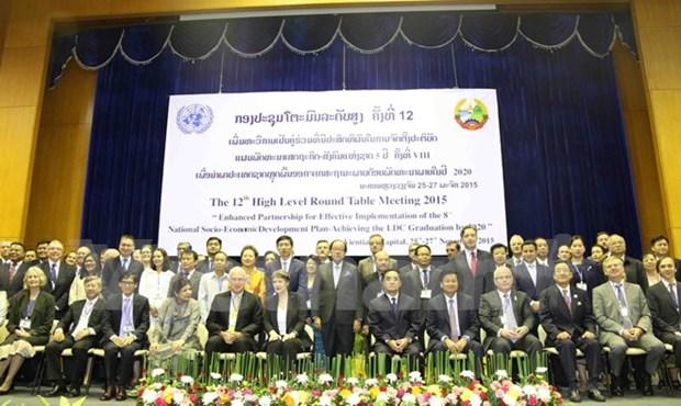 Le Laos ouvre sa 12e table ronde axee sur le developpement socioeconomique hinh anh 1