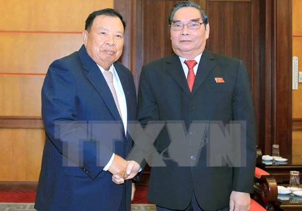 Rencontre de hauts membres des Partis vietnamien et laotien hinh anh 1