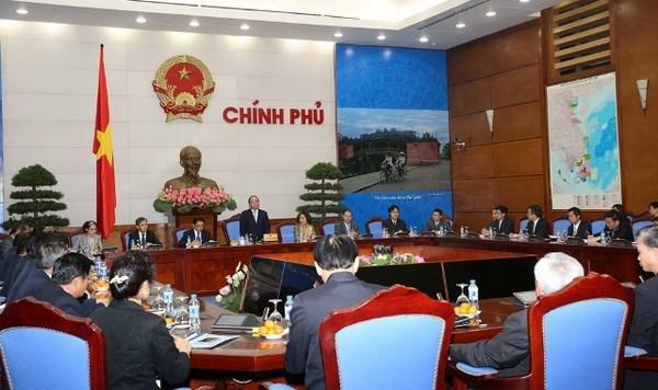 Le vice-PM Nguyen Xuan Phuc recoit de jeunes Laotiens hinh anh 1