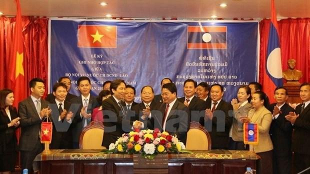 Cooperation entre les ministeres de l'Interieur vietnamien et laotien hinh anh 1