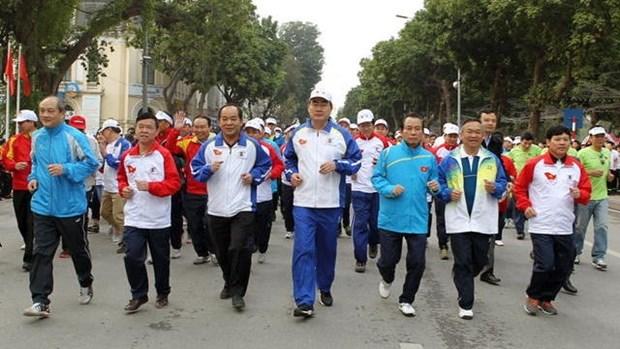 Les habitants de Hanoi font echo a la Course pour la sante hinh anh 1