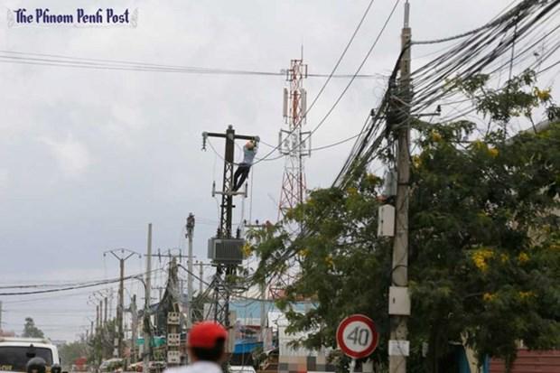 Le Cambodge et la Chine cooperent dans l'electrification rurale hinh anh 1