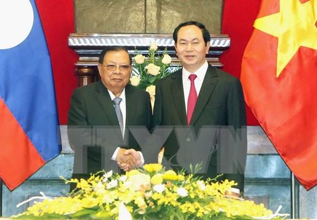 La presse laotienne salue la visite officielle de Bounnhang Vorachit au Vietnam hinh anh 1