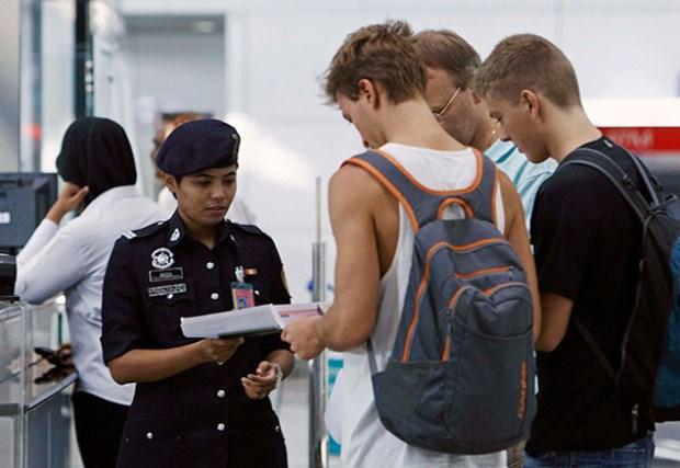Malaisie : lutte contre le trafic humain et la contrefacon de passeports hinh anh 1