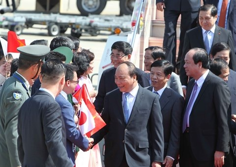 Le Premier ministre Nguyen Xuan Phuc arrive a Nagoya hinh anh 1