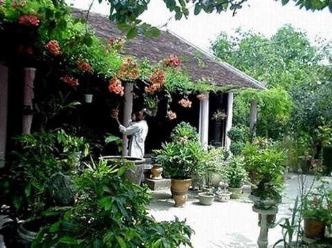 Propos sur la maison traditionnelle des Viet hinh anh 2