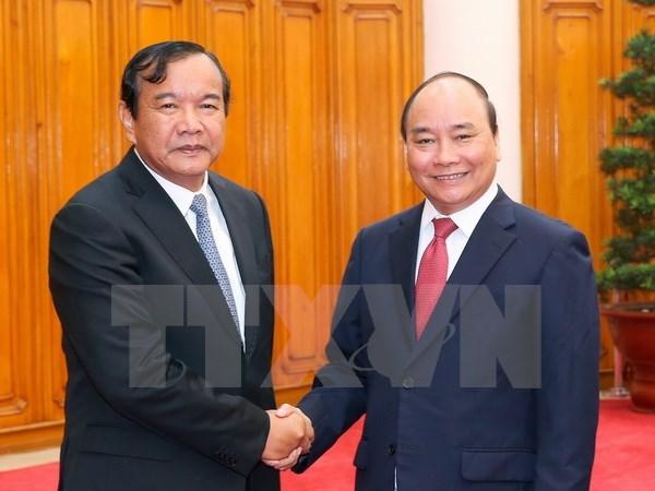Des dirigeants vietnamiens recoivent le ministre cambodgien des Affaires etrangeres hinh anh 2