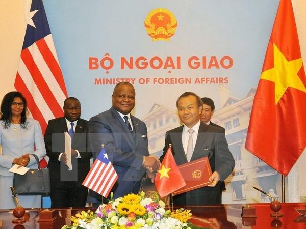 Le Vietnam et le Liberia etablissent leurs relations diplomatiques hinh anh 1