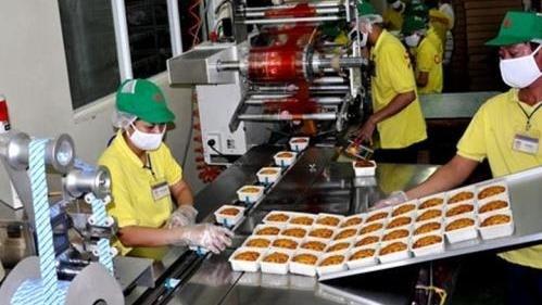 Mondelez Kinh Do: Premier lot de gateaux de lune exporte aux Etats-Unis hinh anh 1