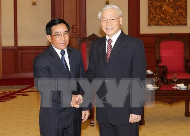 Le secretaire general Nguyen Phu Trong affirme le soutien vigoureux et total du Vietnam au Laos hinh anh 1