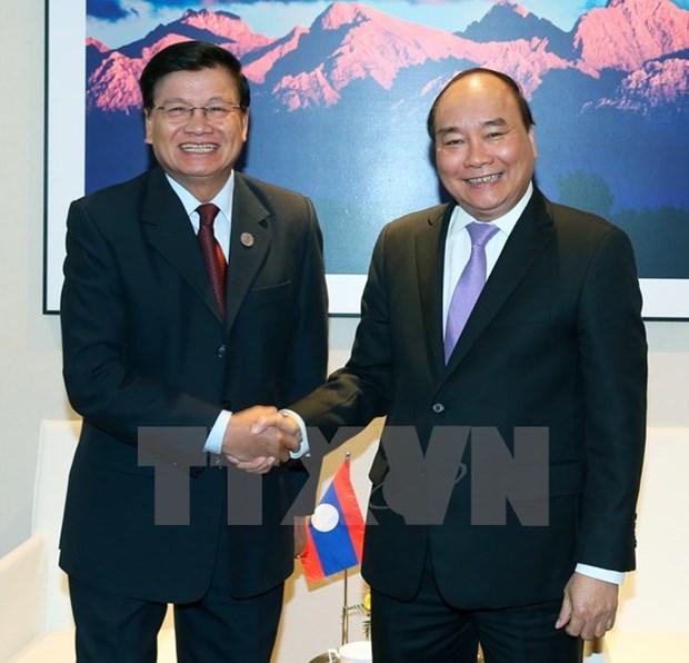 Le PM Nguyen Xuan Phuc rencontre ses homologues chinois, laotien et le president bulgare hinh anh 2