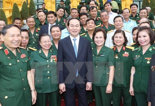 Le president Tran Dai Quang met a l'honneur des hommes d'affaires-veterans de guerre hinh anh 1