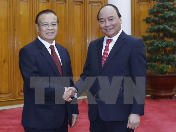 Le Premier ministre vietnamien recoit le ministre laotien des Finances hinh anh 1