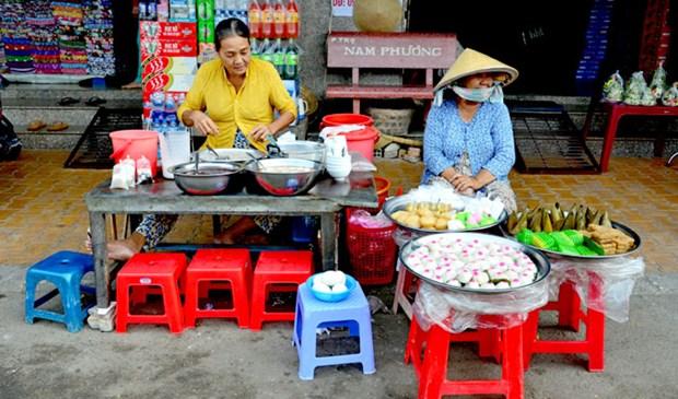 Ho Chi Minh-Ville parmi les 23 villes a la meilleure gastronomie de rue du monde hinh anh 1