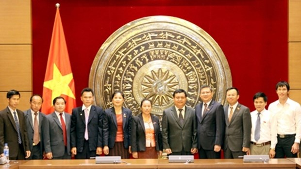 Vietnam et Laos partagent d'experiences dans la gestion des conseils populaires hinh anh 1