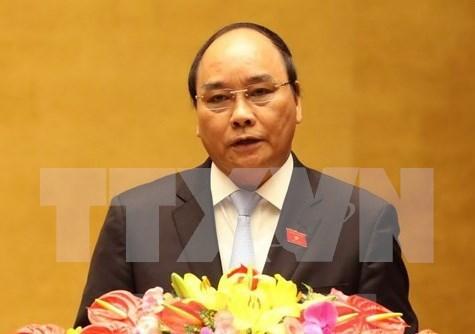 Le PM Nguyen Xuan Phuc rend des visites de courtoisie aux anciens dirigeants laotiens hinh anh 1