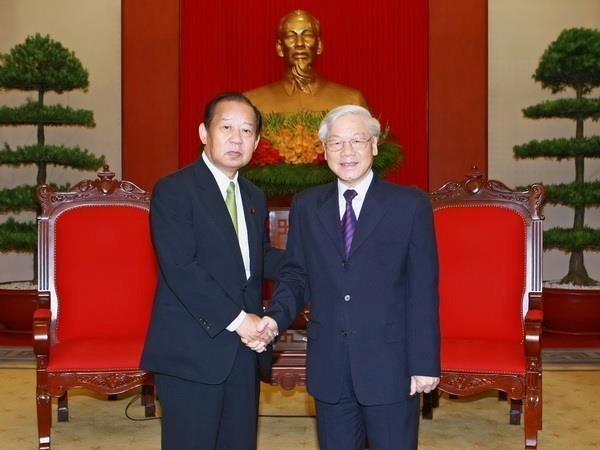 Le chef du PCV Nguyen Phu Trong recoit le secretaire general du PLD (Japon) hinh anh 1