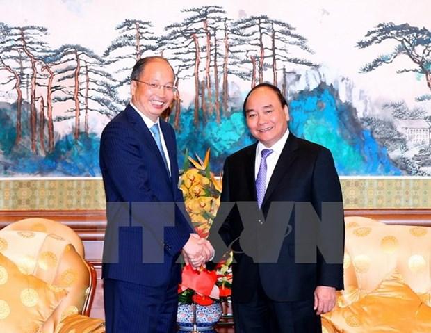 Le Premier ministre Nguyen Xuan Phuc recoit des dirigeants de geants economiques de Chine hinh anh 1