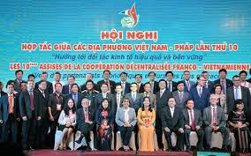 Symposium sur la cooperation economique et touristique Vietnam-France hinh anh 1