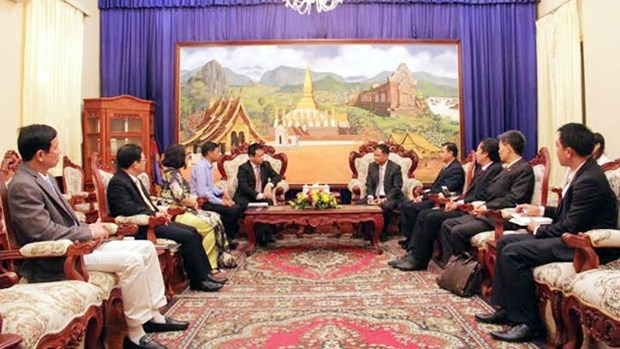 Des responsables du journal Nhan Dan en visite de travail au Laos hinh anh 1
