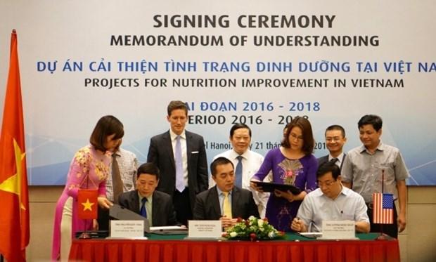 Signature des projets d'amelioration de la nutrition au Vietnam pour la periode 2016-2018 hinh anh 1