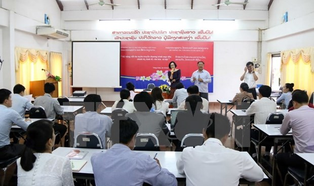 Vietnam et Laos scellent une cooperation dans l'information hinh anh 1