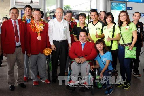Retour triomphal des sportifs handicapes vietnamiens hinh anh 1